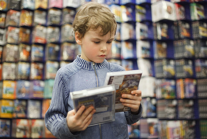 child looking at cd in store