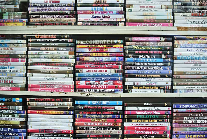 DVD cases stacked on a shelf